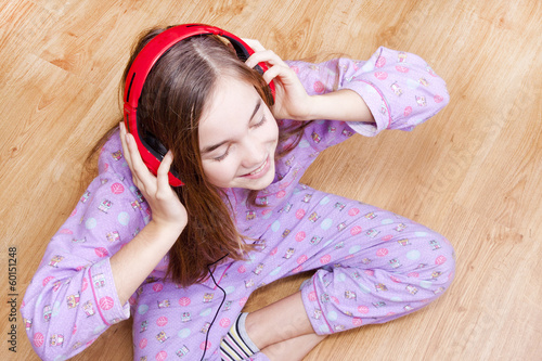 Happy smiling girl with headphones listening to music