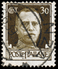 ITALY - CIRCA 1943: Stamps printed in Italy shows image of King