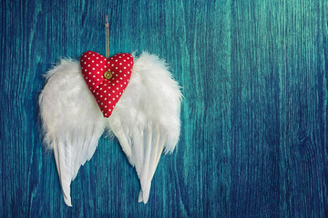 Soft red heart with white wings, valentines day background