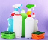Different kinds of kitchen cleaners and colorful sponges,
