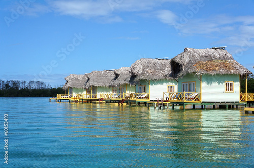 Thatched cabins over the sea