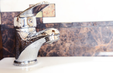 Ceramic sink with chrome fixture, close up