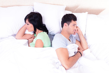 Offended couple in bed