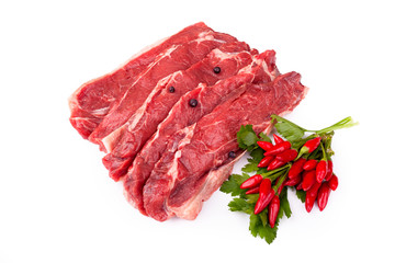 Raw Beefsteaks And Chili Peppers