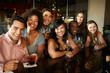 Group Of Friends Enjoying Drink At Bar Together