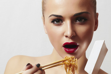Beautiful Woman are Eating Noodles.Food.Enjoy meal