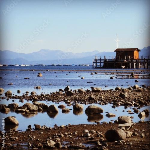 See mit Bootssteg und Haus
