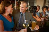 Mature Couple Enjoying Drink In Bar Together - Fine Art prints