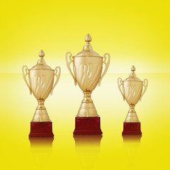 Three gold trophies on bright yellow background