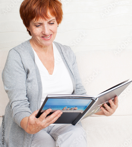 Woman looking photo book
