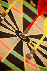 Arrow hit black and yellow Bullseye centre while two miss