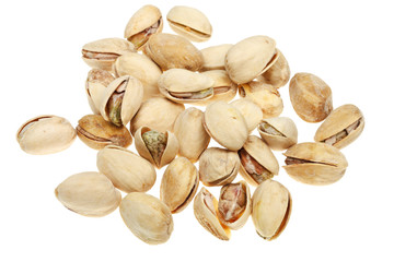 many salted pistachio nuts close up