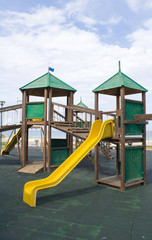 Wooden kids game structure in pubblic area