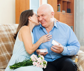 Mature man presenting woman jewel