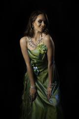 Brunette woman smiling in evening dress