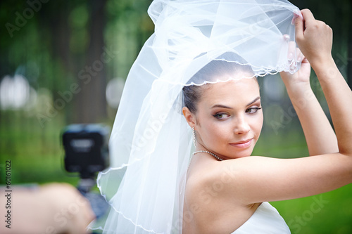 Beautiful bride posing for videographer