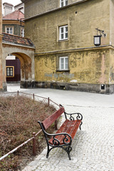 Empty bench in an old town in Warsaw