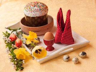 Easter still life with traditional kulich on white tray