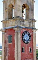 Old tower clock and the town of Corfu, Greece, Europe