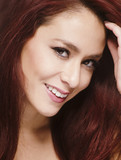 Pretty woman with red hair smilling