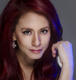 Portrait of young woman thinking red hair
