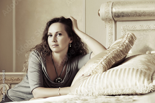 Beautiful woman relaxing in a bedroom