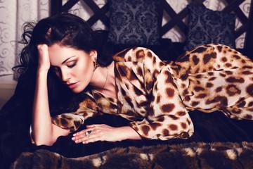 beautiful girl with black hair lying on sofa