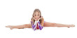 Studio shot of cute young gymnast sitting on split