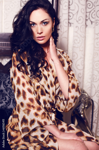 beautiful girl with black hair  in leopard print robe