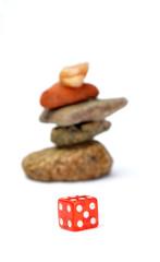 red dice agains stones