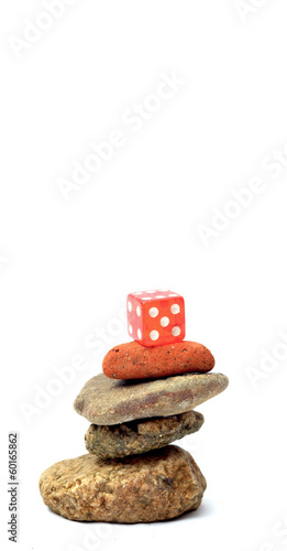 rede dice on the top of stones
