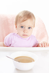 The baby eats children's porridge