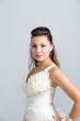 beautiful girl in a white wedding dress profile