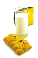 Isolated image of a glass of milk, cheese and cake
