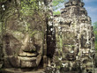 Giant Stone Faces at Bayon Temple in Angkor, Cambodia