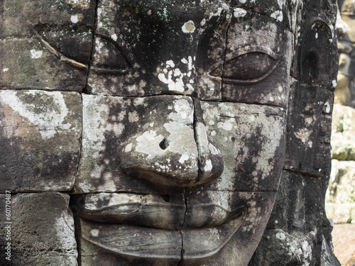 Giant Stone Face at Bayon Temple in Angkor, Cambodia