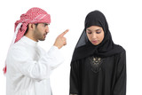 Arab couple with a man arguing to his wife
