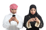 Saudi couple addicted to the smart phone poster