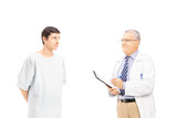 Doctor diagnosing a concerned male patient