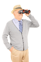 Senior gentleman looking through binoculars