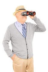 Senior gentleman looking through binoculars