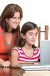 Hispanic teenager and her mom working on a laptop computer