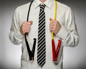 Man wearing tie with jumper cables