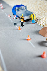 Road renovation in progress . Macro figurine