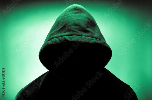 Man wearing hood with face in shadow
