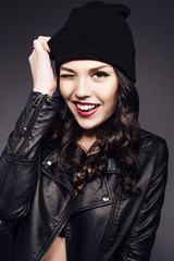 beautiful smiling girl in black hat