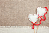 Textile hearts, ribbon and linen cloth on the burlap