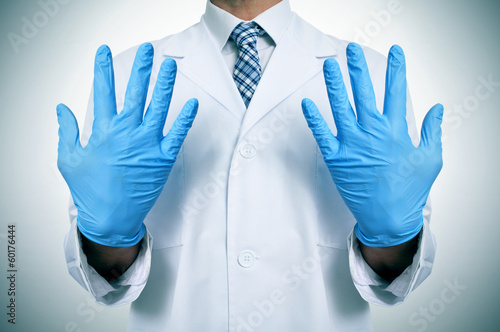 a doctor with medical gloves