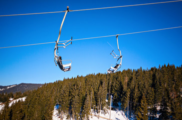 winter ski lift chair at snowy landscape