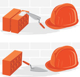 Trowel with bricks and safety helmet